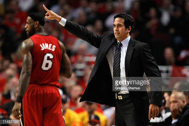 Head coach Erik Spoelstra of the Miami Heat reacts as LeBron James look on in the background against the Chicago Bulls in Game Two of the Eastern...