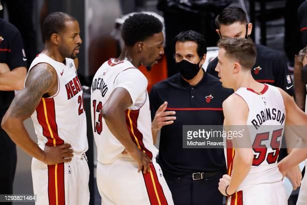 Head coach Erik Spoelstra of the Miami Heat talks with Andre Iguodala, Bam Adebayo and Duncan Robinson against the Milwaukee Bucks during the second...