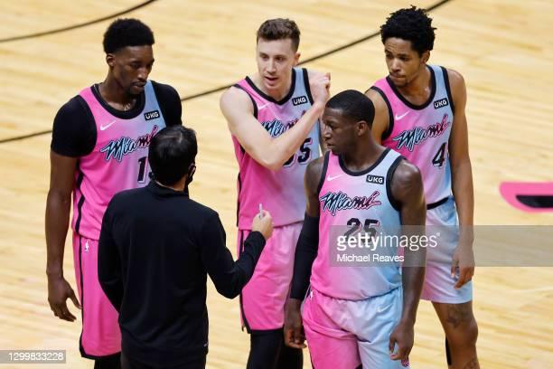 Head coach Erik Spoelstra of the Miami Heat talks with Bam Adebayo, Duncan Robinson, Kendrick Nunn and KZ Okpala against the LA Clippers during the...