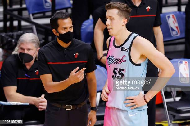 Head coach Erik Spoelstra of the Miami Heat talks with Duncan Robinson against the Boston Celtics during the second quarter at American Airlines...