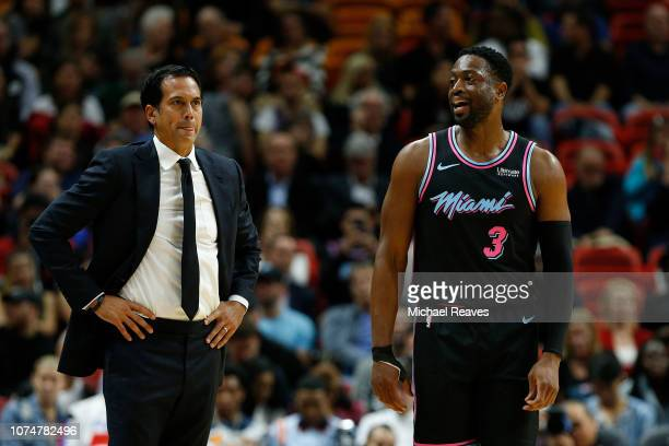 Head coach Erik Spoelstra of the Miami Heat talks with Dwyane Wade against the Atlanta Hawks at American Airlines Arena on November 27 2018 in Miami...