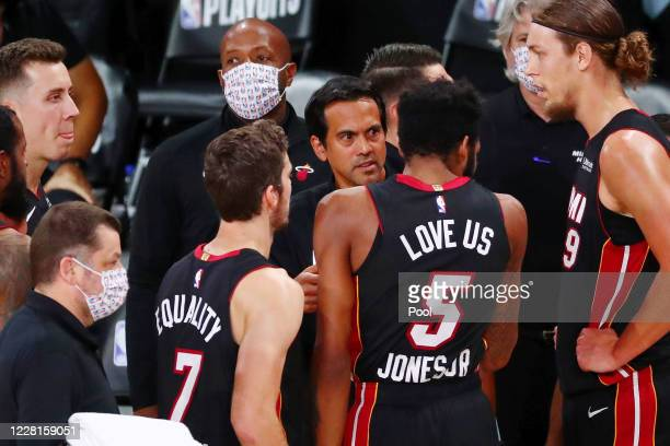 Head coach Erik Spoelstra of the Miami Heat talks with his team during a time out during the first half of Game 3 of an NBA basketball first-round...