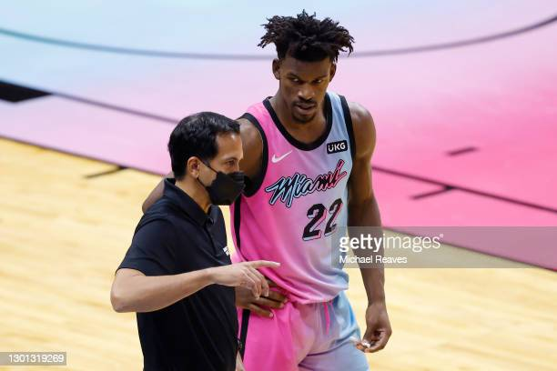 Head coach Erik Spoelstra of the Miami Heat talks with Jimmy Butler against the New York Knicks during the fourth quarter at American Airlines Arena...