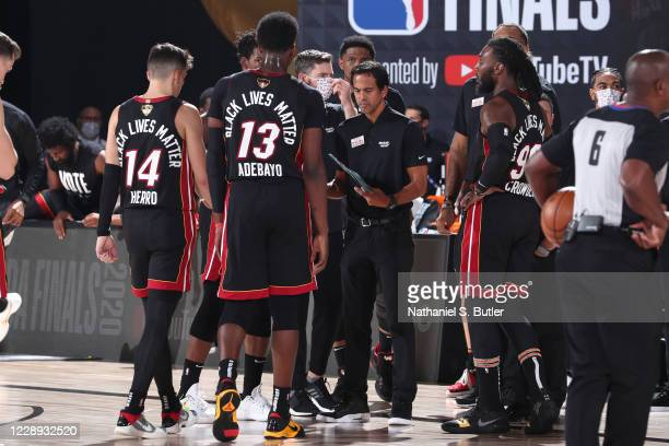 Head coach Erik Spoelstra of the Miami Heat talks with the team in the huddle during Game Four of the NBA Finals on October 6, 2020 at AdventHealth...