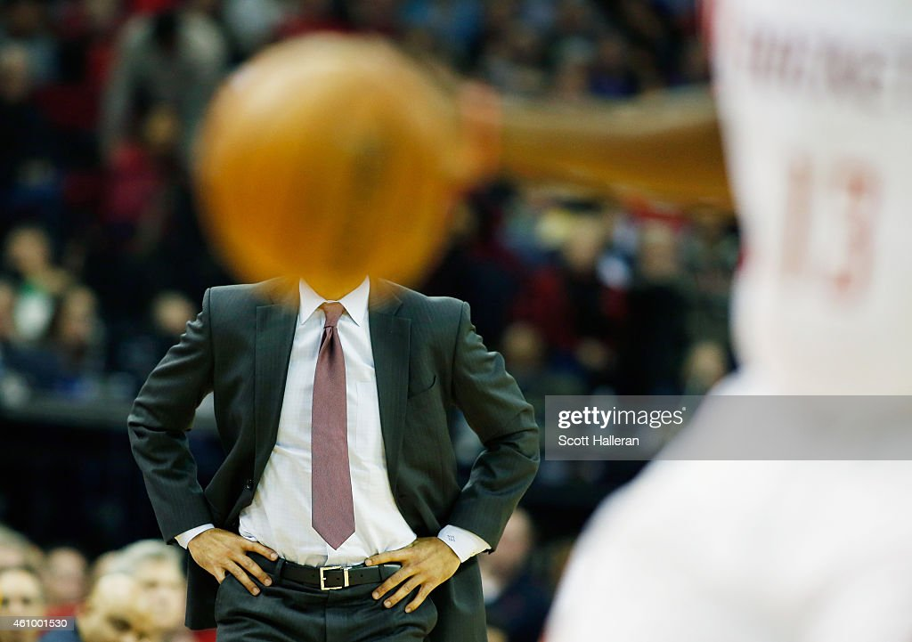 Head coach Erik Spoelstra of the Miami Heat watches the action as James Harden #13 of the Houston Rockets takes the ball up court during their game at the Toyota Center on January 3, 2015 in Houston, Texas.