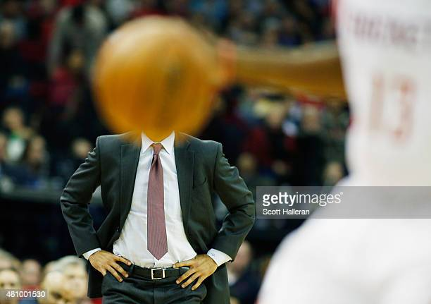 Head coach Erik Spoelstra of the Miami Heat watches the action as James Harden of the Houston Rockets takes the ball up court during their game at...