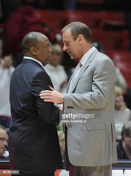 Head coach Ernie Kent of the Washington State Cougars and head coach Larry Krystkowiak of the Utah Utes meet after Utah's 8664 win at the Jon M...