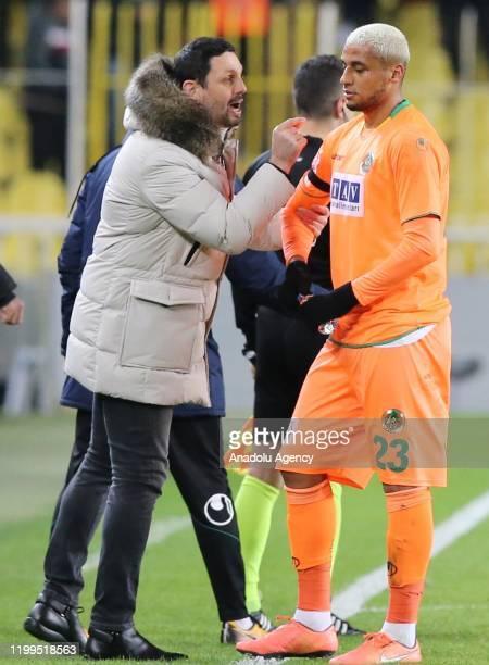 Head Coach Erol Bulut of Aytemiz Alanyaspor speaks with his player Wilington Souza Silva during the Turkish Super Lig soccer match between Fenerbahce...