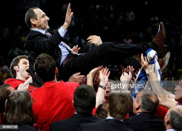 Head Coach Ettore Messina of CSKA Moscow is hoisted up by his players as they celebrate victory at the end of the Euroleague Final Four final...
