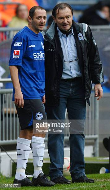 Head coach Ewald Lienen and Oliver Neuville of Bielefeld look on during the Second Bundesliga match between Arminia Bielefeld and VfL Osnabrueck at...