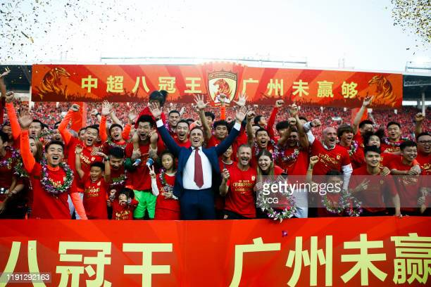 Head coach Fabio Cannavaro of Guangzhou Evergrande and his players celebrate winning the 2019 Chinese Super League title after the 30th round match...