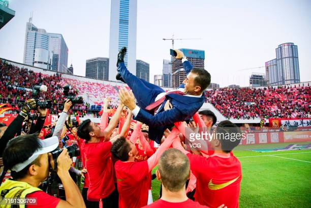 Head coach Fabio Cannavaro of Guangzhou Evergrande is thrown up in the air by his players as they celebrate winning the 2019 Chinese Super League...
