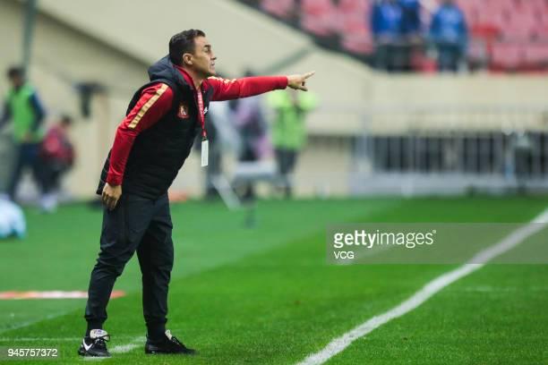 Head coach Fabio Cannavaro of Guangzhou Evergrande reacts during the 2018 Chinese Super League 6th round match between Shanghai Shenhua and Guangzhou...