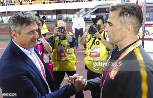 Head coach Fabio Cannavaro of Guangzhou Evergrande shakes hands with head coach Dragan Stojkovic of Guangzhou RF prior to the 2018 Chinese Football...