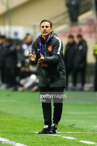 Head coach Fabio Cannavaro of Guangzhou Evergrande speaks to his players during the 2018 Chinese Football Association Super Cup between Shanghai...