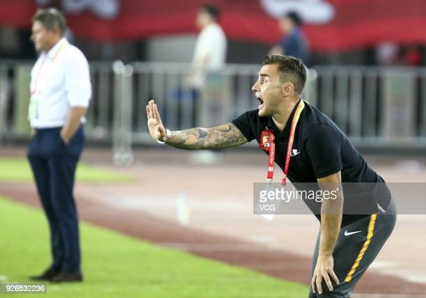 Head coach Fabio Cannavaro of Guangzhou Evergrande speaks to his players during the 2018 Chinese Football Association Super League first round match...