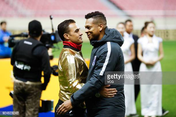 Head coach Fabio Cannavaro of Guangzhou Evergrande speaks with Fredy Guarin of Shanghai Shenhua after the 2018 Chinese Football Association Super Cup...