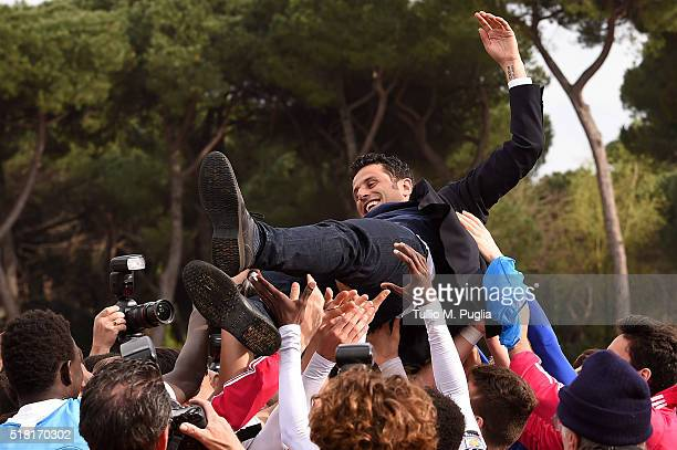 Head coach Fabio Grosso of Juventus is congratulated after winning the Viareggio Juvenile Tournament match between FC Juventus and US Citta di...