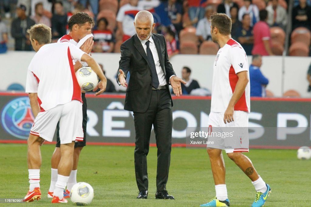 head coach Fabrizio Ravanelli of Ajaccio AC reacts with his player during the French League 1 between Paris Saint-Germain FC and AC Ajaccio, at Parc des Princes on August 18, 2013 in Paris, France.