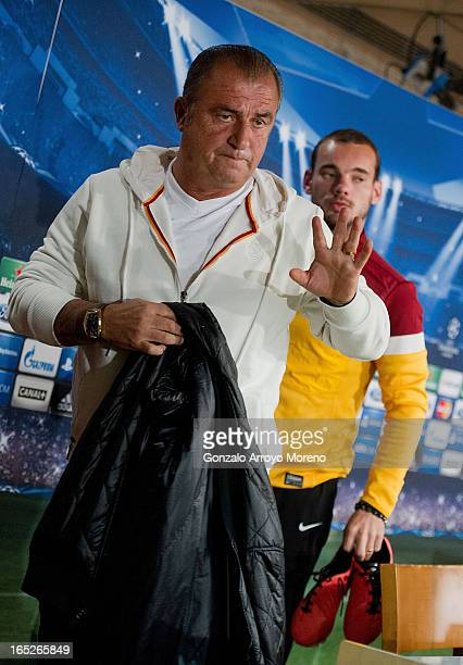 Head coach Fatih Terim leaves the press conference room with Galatasaray player Wesley Sneijder after a press conference ahead of the UEFA Champions...