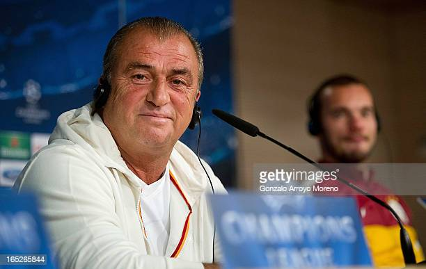 Head coach Fatih Terim listens to questions from the media during a press conference ahead of the UEFA Champions League Quarterfinal match between...