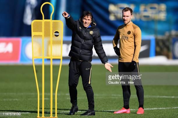 Head coach FC Internazionale Antonio Conte and Christian Eriksen of FC Internazionale chat during FC Internazionale training session at Appiano...