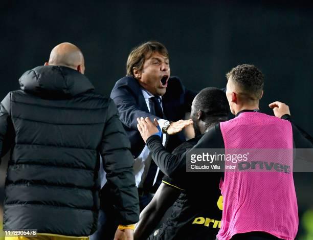Head coach FC Internazionale Antonio Conte and Romelu Menama Lukaku Bolingoli of FC Internazionale celebrate during the Serie A match between Brescia...