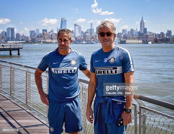 Head Coach FC Internazionale Roberto Mancini and assistant coach Sylvinho pose for a photo in front of the New York skyline after the FC...
