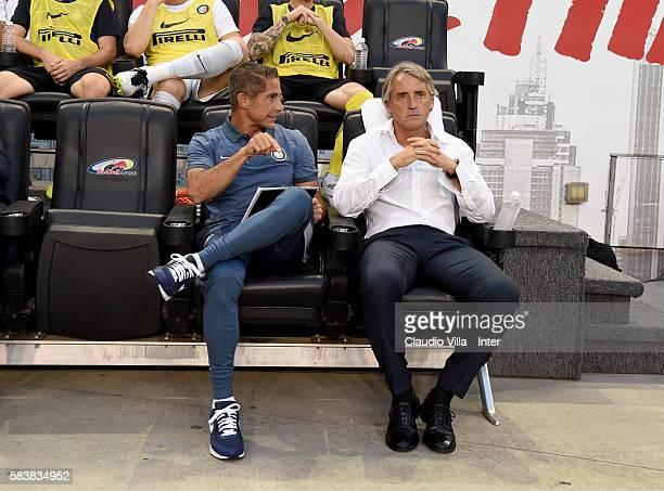 Head coach FC Internazionale Roberto Mancini and assistant coach FC Internazionale Sylvinho chat before the friendly match between FC Internazionale...