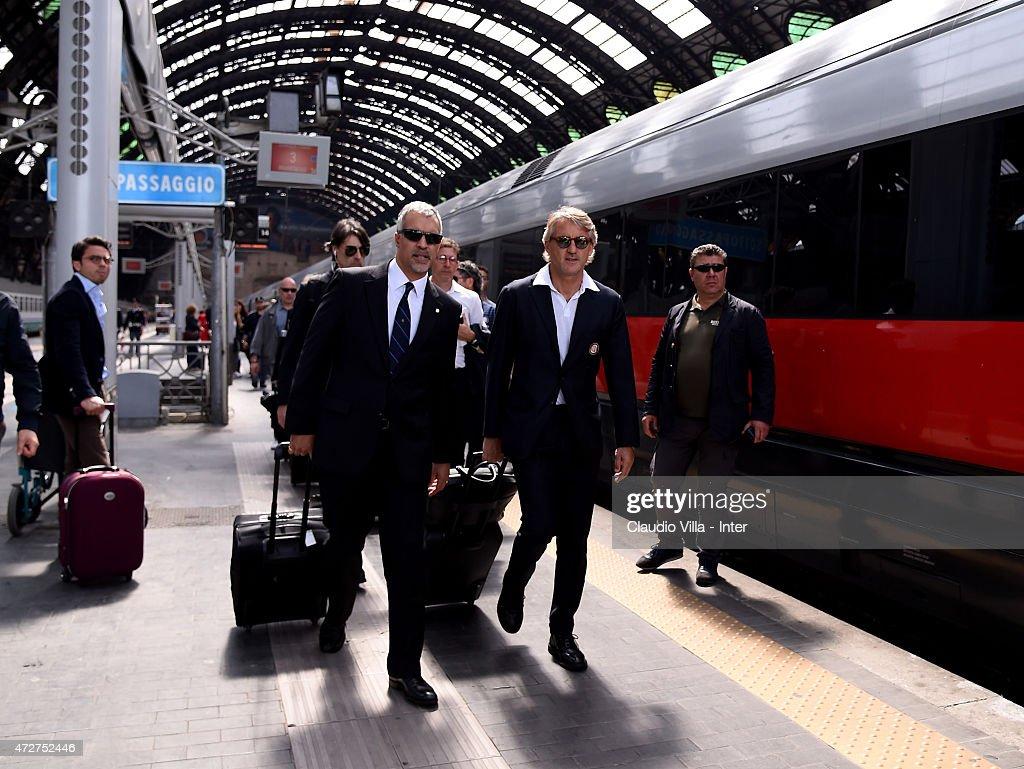 Head coach FC Internazionale Roberto Mancini (R) and CEO of FC Internazionale Milano Michael Bolingbroke depart to Rome at train station on May 9, 2015 in Milano, Italy.