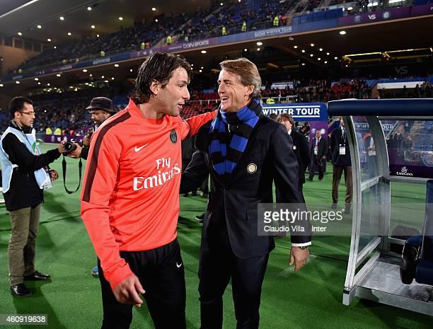 Head coach FC Internazionale Roberto Mancini and Maxwell of Paris Saint Germain prior to the Qatar Winter Tour match betweeen Paris Saint Germain and...