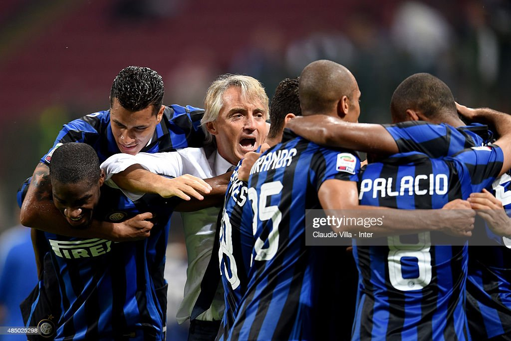 Head coach FC Internazionale Roberto Mancini (C) celebrates during the Serie A match between FC Internazionale Milano and Atalanta BC at Stadio Giuseppe Meazza on August 23, 2015 in Milan, Italy.