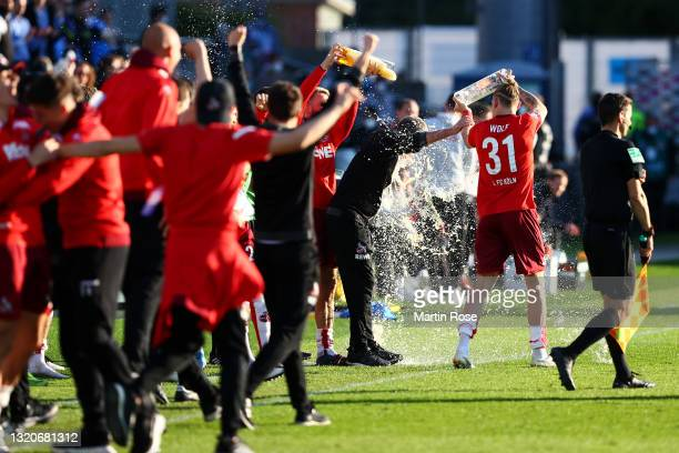 Head coach FC Koln, Friedhelm Funkel is covered in beer after victory in the Bundesliga playoff leg two match between Holstein Kiel and 1. FC Köln at...