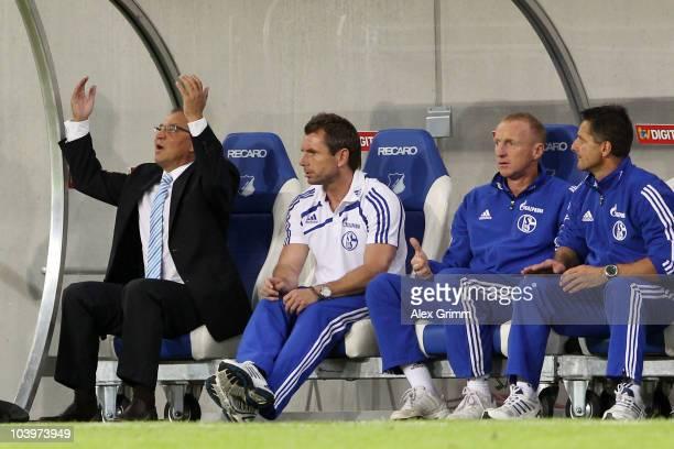 Head coach Felix Magath, and assistant coaches Bernd Hollerbach and Seppo Eichkorn of Schalke react during the Bundesliga match between 1899...