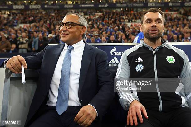 Head coach Felix Magath and assistant oach Bernd Hollerbach of Wolfsburg sit on the bench during the Bundesliga match between FC Schalke 04 and VfL...