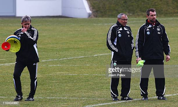 Head coach Felix Magath and assistent coach Pierre Littbarski and assistend coach Bernd Hollerbach are seen during the training session of VfL...