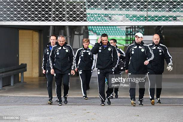 Head coach Felix Magath and his assistant coaches are seen prior to a VfL Wolfsburg training session on October 23, 2012 in Wolfsburg, Germany.
