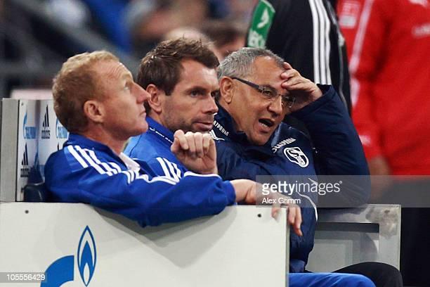 Head coach Felix Magath and his assistants Bernd Hollerbach and Seppo Eichkorn of Schalke react during the Bundesliga match between FC Schalke 04 and...