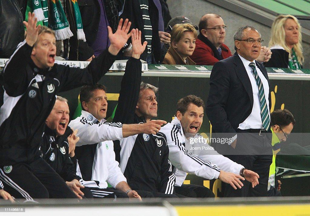 Head coach Felix Magath (R), asisstent coach Bernd Hollerbach (2nd R) and Assistent coach Pierre Littbarski (3rd R)of Wolfsburg are seen during the Bundesliga match between VfL Wolfsburg and Eintracht Frankfurt at Volkswagen Arena on April 3, 2011 in Wolfsburg, Germany.