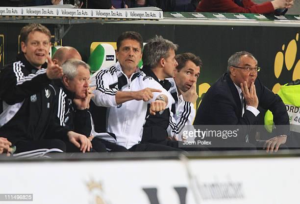 Head coach Felix Magath , asisstent coach Bernd Hollerbach and Assistent coach Pierre Littbarski of Wolfsburg are seen during the Bundesliga match...