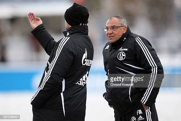Head coach Felix Magath of Schalke and assistant coach Bernd Hollerbach attend the FC Schalke training session at the training ground on November 30,...