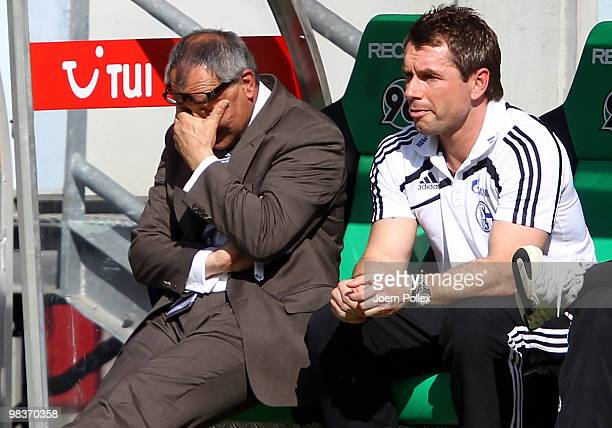 Head coach Felix Magath of Schalke and coach Bernd Hollerbach look on during the Bundesliga match between Hannover 96 and FC Schalke 04 at AWD Arena...