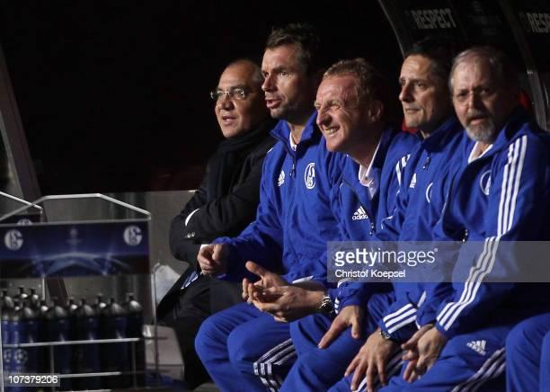 Head coach Felix Magath of Schalke assistant coach Bernd HOllerbach assistant coach Seppo Eichkorn and condition coach Werner Leuthart sit on the...