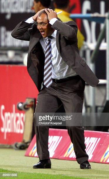 Head coach Felix Magath of Schalke looks angry during the Bundesliga match between 1899 Hoffenheim and FC Schalke 04 at Rhein-Neckar Arena on August...