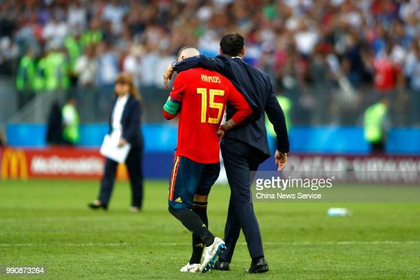 Head coach Fernando Hierro and Sergio Ramos of Spain react after losing the penalty shootout during the 2018 FIFA World Cup Russia Round of 16 match...