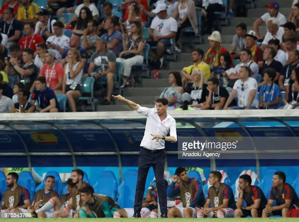Head coach Fernando Hierro of Spain national football team gives tactics to his players during the 2018 FIFA World Cup Russia Group B match between...