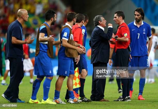 Head coach Fernando Santos of Greece speaks with referee Benjamin Williams before being sent off at the end of the extra time during the 2014 FIFA...