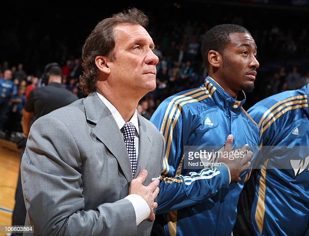 Head Coach Flip Saunders and John Wall of the Washington Wizards stand during the National Anthem pregame against the Cleveland Cavaliers at the...