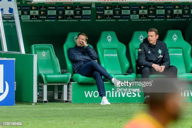 Head coach Florian Kohfeldt of SV Werder Bremen and assistant coach Tim Borowski of SV Werder Bremen look on during the Bundesliga match between SV...