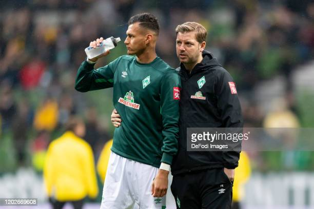 head coach Florian Kohfeldt of SV Werder Bremen and Davie Selke of SV Werder Bremen looks on prior to the Bundesliga match between SV Werder Bremen...